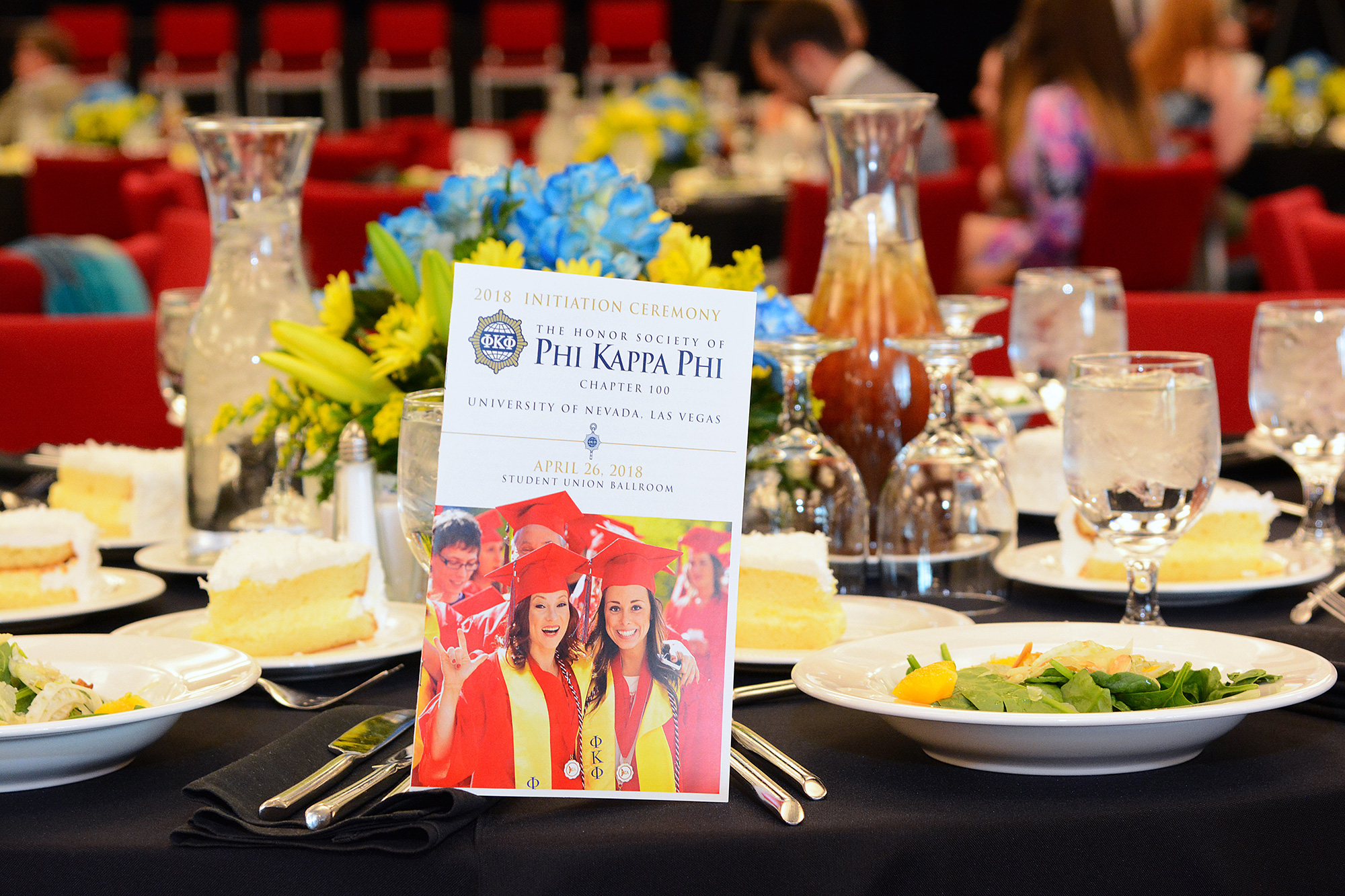 Banquet table featuring a Phi Kappa Phi program
