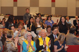 It's an honor - Top students stand as their names are called during the induction ceremony.