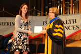 Emilie-Ariel Letourneau, accepts recognition for her honor from Margaret Louis during the ceremony.