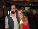 Recent UNLV graduates Ronnie Vanucci (also known as the drummer for The Killers) with Melaney Scarberry, sporting her PKP honor cord and stole.